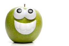 Granny Smith Apple. A very happy Granny Smith green apple Royalty Free Stock Photography