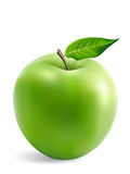 Granny Smith Apple mit einem Blatt Lizenzfreie Stockfotos