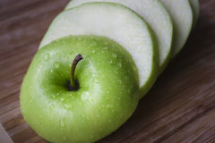Granny smith apple sliced. Royalty Free Stock Photos