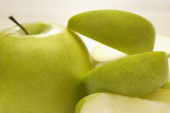 Granny Smith Apple With Slices Stock Image