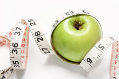 Granny Smith Apple and Tape Measure Royalty Free Stock Photography