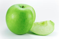 Granny smith, apple wedge. A granny smith apple with an apple wedge on the side Stock Photo