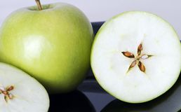 Granny smith apples. Whole and cut tart green Granny Smith apples Royalty Free Stock Photography