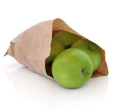 Granny Smith Apples. Green apples in a brown paper bag over white background. Granny Smith variety Stock Image