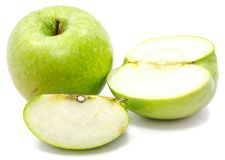 Apple Granny Smith. Granny Smith apples, one whole, sliced and half, isolated on white backgroundn Stock Image