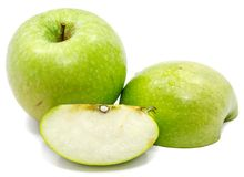 Apple Granny Smith. Granny Smith apples, one whole, sliced and half, isolated on white backgroundn Royalty Free Stock Images