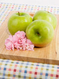 Granny Smith Apples and Pink Carnation Flowers Stock Photography