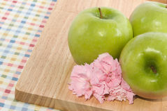 Granny Smith Apples and Pink Carnations Stock Photos