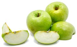Apple Granny Smith. Granny Smith apples, two whole, sliced and one half, isolated on white background Royalty Free Stock Photography