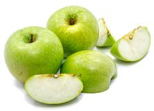Apple Granny Smith. Granny Smith apples, two whole, sliced and one half, isolated on white backgroundn Royalty Free Stock Image