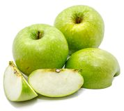 Apple Granny Smith. Granny Smith apples, two whole, sliced and one half, isolated on white backgroundn Stock Images