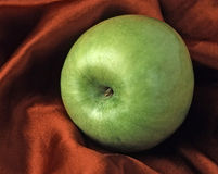 Granny Smith FOOD ART. Food StillLife. Food Art.  Granny Smith on Satin Royalty Free Stock Photography