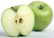 Granny Smith Green apple. Half of a green apple and a whole behind stock photography