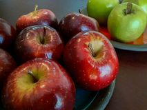 Two colored apples - green and red in ceramic plates Stock Photo