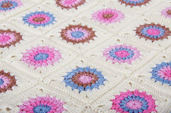 Granny square blanket in pink, blue and brown Stock Images