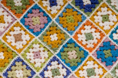 Granny squares crochet blanket. Baby crochet blanket crafted in colorful granny squares Stock Photo