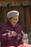 Granny vendor in an ancient Chinese town Royalty Free Stock Photography