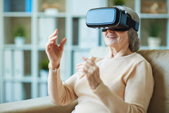 Granny with vr headset Stock Photo