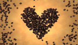 Grano de café de la forma del corazón en el papel viejo Fotos de archivo libres de regalías