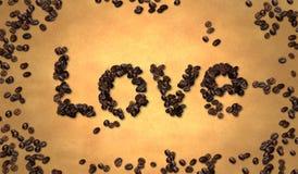 Grano de café del amor en el papel viejo Fotografía de archivo libre de regalías