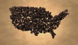 Grano de café del mapa de América en el papel viejo Fotografía de archivo