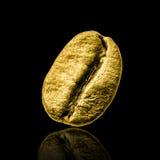 Grano de café del oro Imagen de archivo libre de regalías
