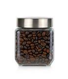 Grano de café en la botella de cristal Imagen de archivo