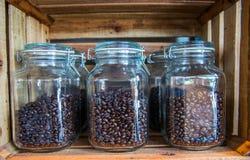 Grano de café en tarro Fotografía de archivo