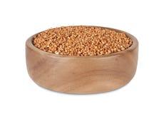 Grano saraceno in ciotola di legno Immagini Stock