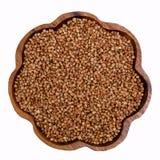 Grano saraceno organico in un piatto fotografia stock