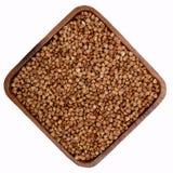 Grano saraceno organico in un piatto immagini stock libere da diritti