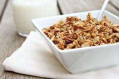 Granola. Bowl of granola with glass of milk