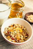 Granola with almonds, goji berry and peanuts in a jar Stock Photo