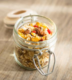 Granola with almonds, goji berry and peanuts in a jar Royalty Free Stock Images