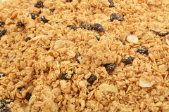 Granola background. A background of honey oat granola with almonds and raisins Royalty Free Stock Photography