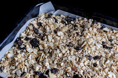 Granola in a baking tray from side closeup Royalty Free Stock Photo