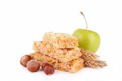 Granola bar and apple Stock Images