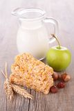 Granola bar and apple Royalty Free Stock Images