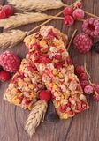 Granola bar and berries Stock Photo