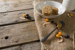Granola bar and berry fruit on wooden table Stock Photography