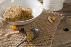 Granola bar and berry fruit on wooden table Royalty Free Stock Photography