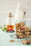 Granola bar on a blue rustic table Royalty Free Stock Photos