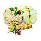 Granola bar and bread with lingonberries and apples Royalty Free Stock Image