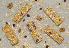Granola bar. Cereal granola bar with nuts, fruit and berries on a gray stone table. Healthy sweet dessert snack. Vegan food. royalty free stock photo
