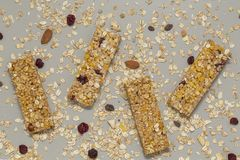 Granola bar. Cereal granola bar with nuts, fruit and berries on a gray stone table. Healthy sweet dessert snack. Vegan food. stock images
