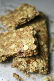 Granola Bar. Crispy broken cinnamon granola bar on kitchen counter Stock Image