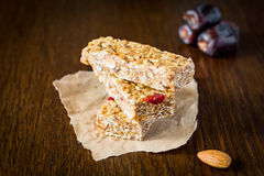 Granola bar or energy bar on brown background Stock Photos