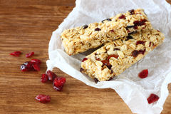 Granola bar or energy bar on wooden background. Pic Royalty Free Stock Images
