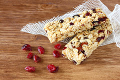 Granola bar or energy bar on wooden background. Pic Stock Photo