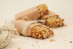 Granola bar or flapjacks on baking paper with hemp Stock Image